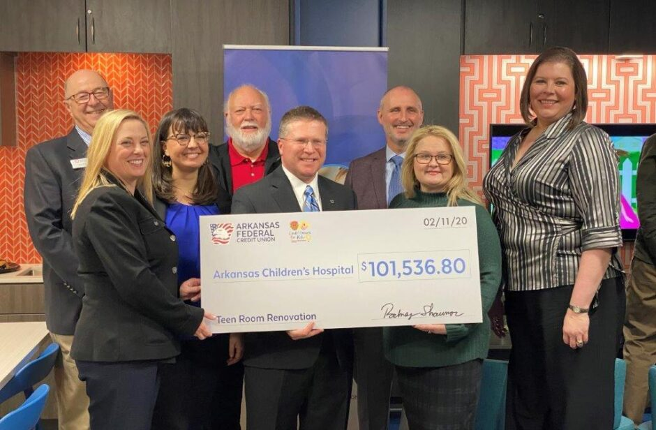 Arkansas Federal Credit Union employees at Arkansas Children's Hospital holding a checking for $101,536.80