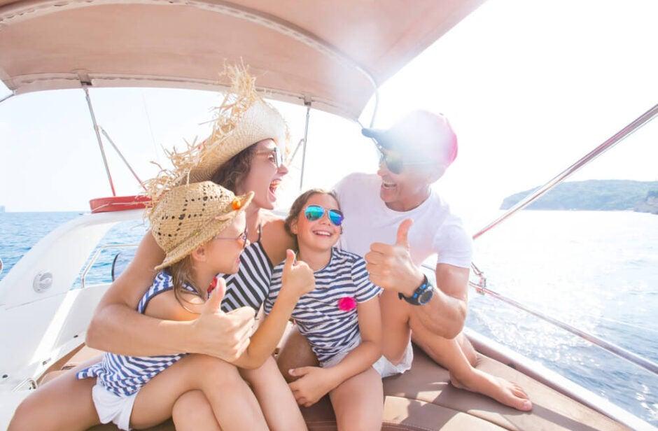 Family on boat at lake