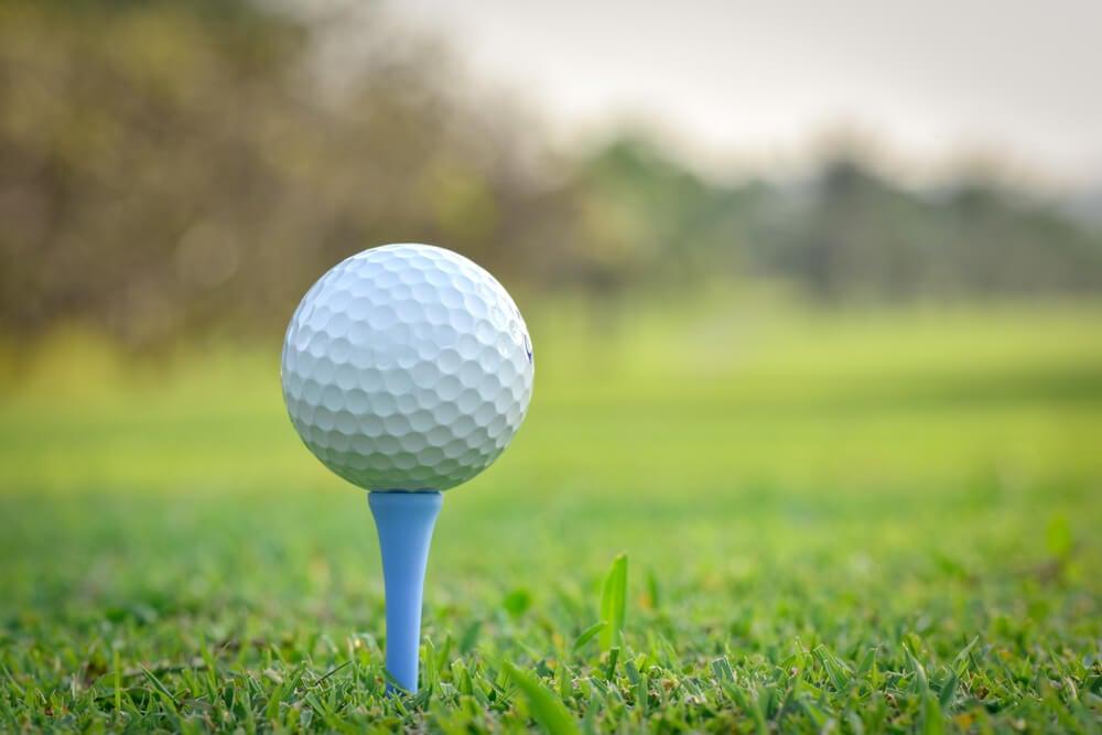 Golf ball of a golf tee on a golf course