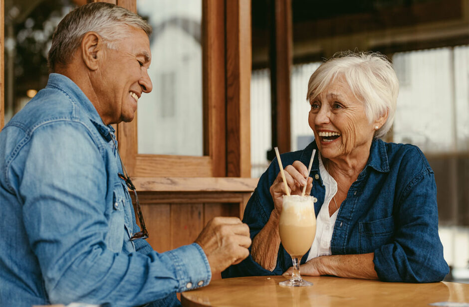 Happy couple drinking milkshake