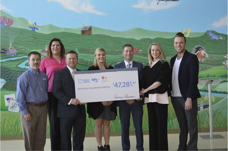 Arkansas Federal Credit Union employees at Arkansas Children's Hospital holding a check for $47,281.81