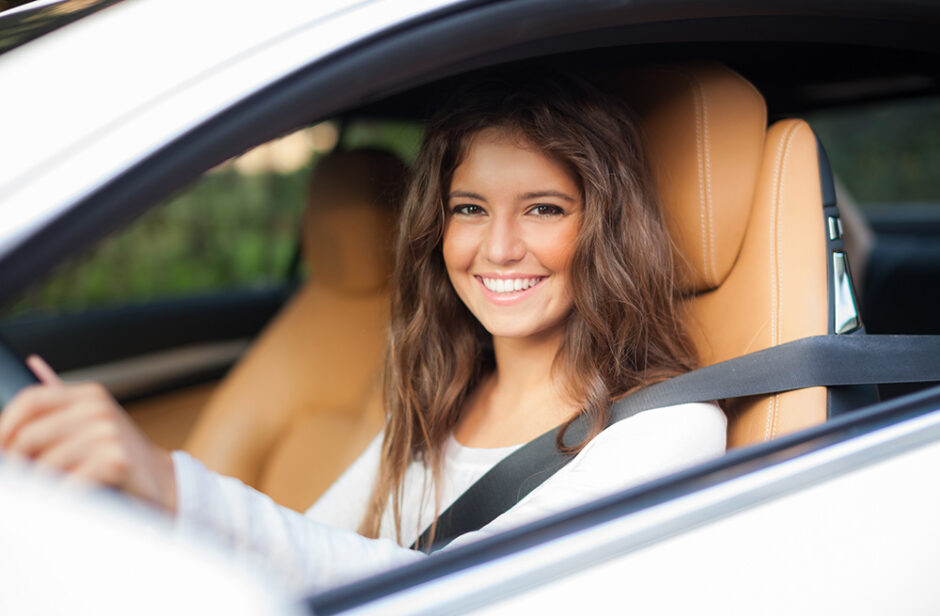 Woman sitting in the front seat of a car