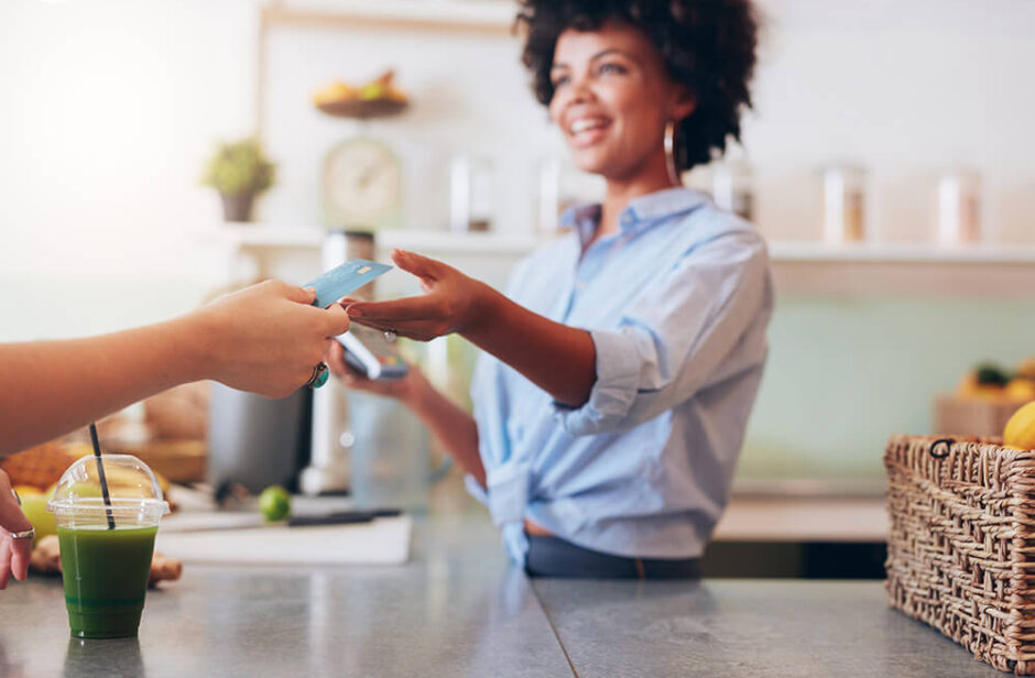 Woman business owner accepting credit card from customer