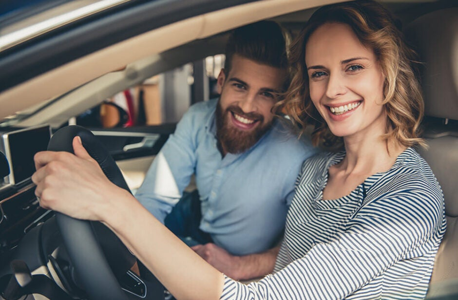 Woman and man inside a car