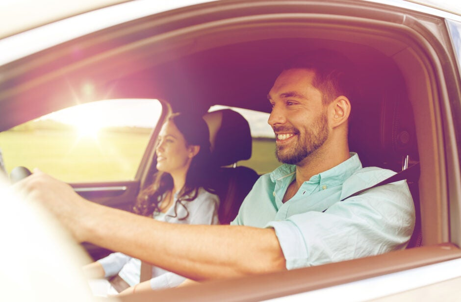 Couple driving around smiling