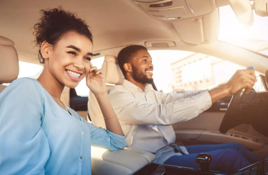 two people driving happily