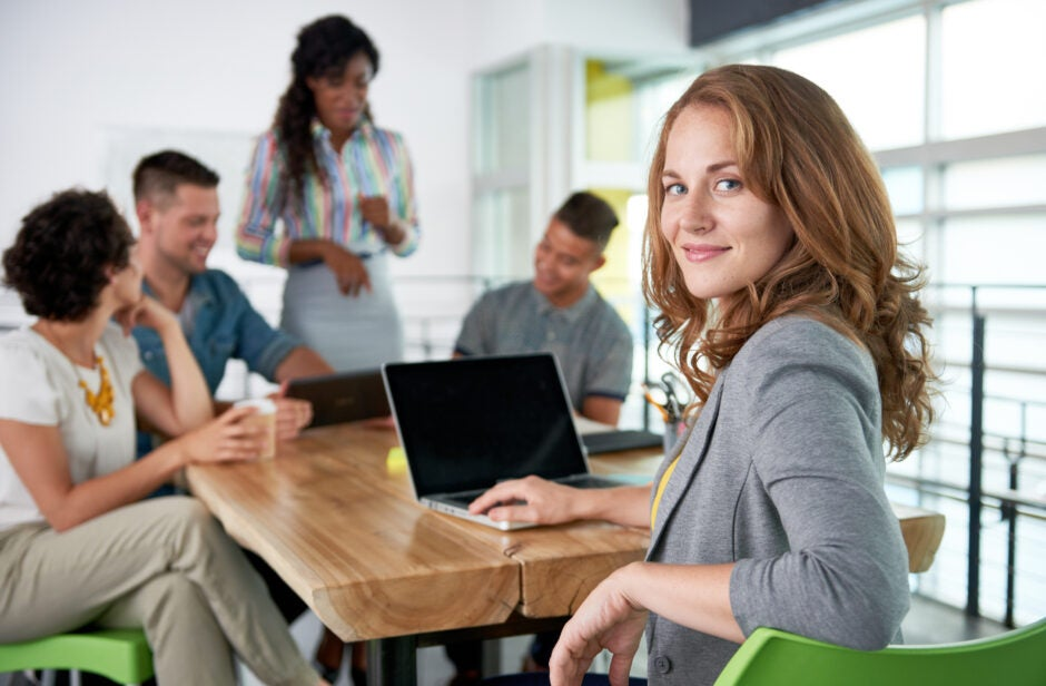 Woman smiling at conference table